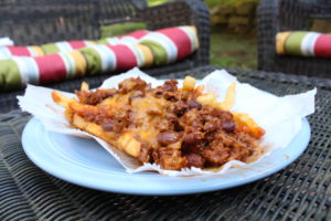 Checks Chili Fries- The chili cheese fries ($6.95) are one of Checks Cafe's famous dishes. The golden brown fries are topped with an abundance of chili, meat, and melted cheddar cheese to complete their well-known chili dish. It is served in a basket instead of a plate adding to the dish's uniqueness.